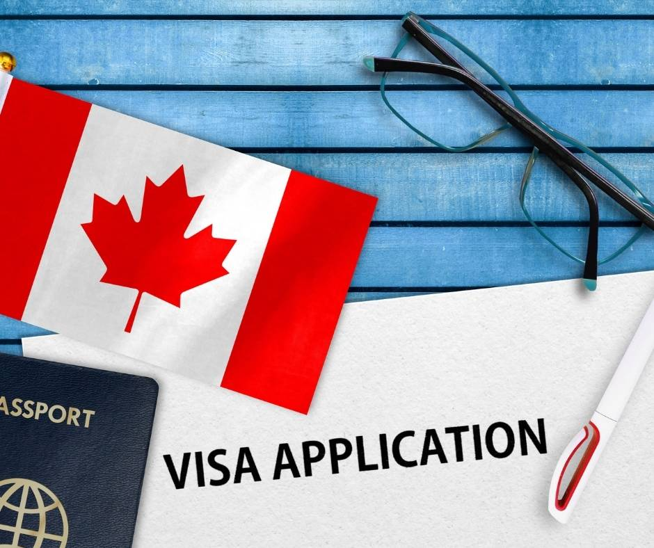 canada visitor visa application with canadian flag